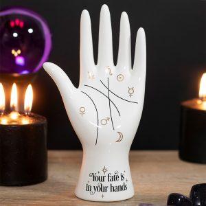 white ceramic palmistry hand
